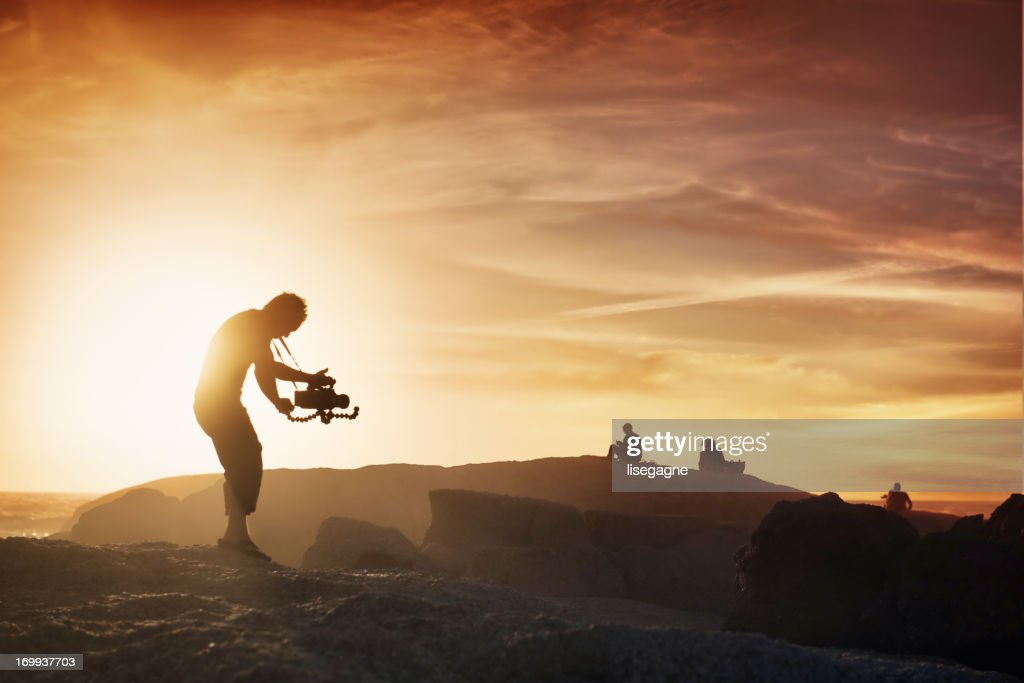 Cameraman at sunset : Stock Photo