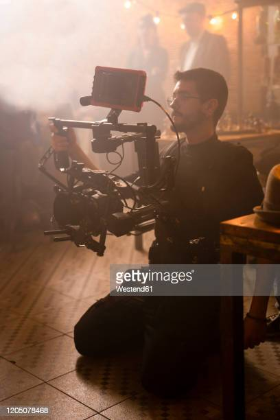 cameraman at work on movie set - gifted movie stock pictures, royalty-free photos & images