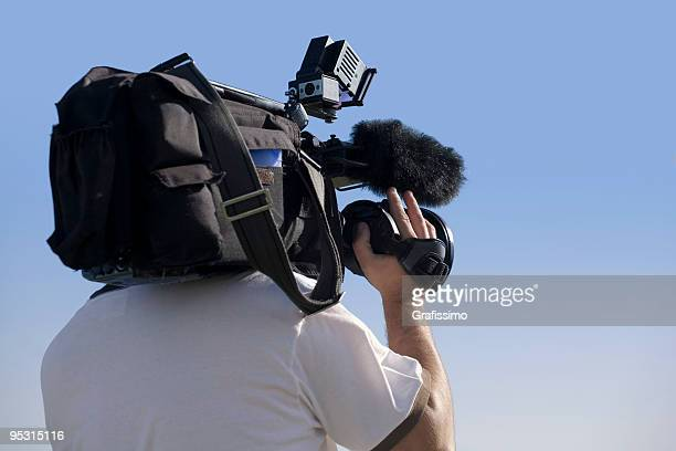 cameraman at work outdoors - cinematographer stock pictures, royalty-free photos & images
