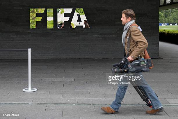 A cameraman attends a press conference at the FIFA headquarters on May 27 2015 in Zurich Switzerland Swiss police on Wednesday raided a Zurich hotel...