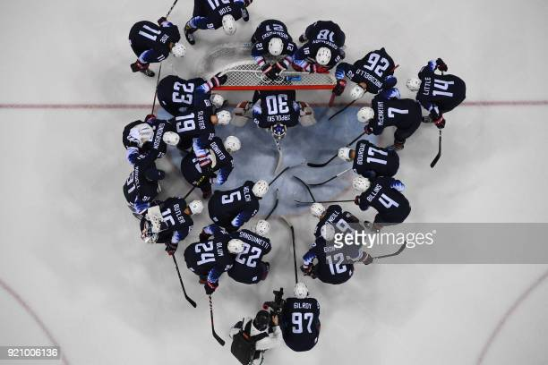 TOPSHOT A cameraman bottom films the US team getting ready for the men's playoff qualifications ice hockey match between the United States and...