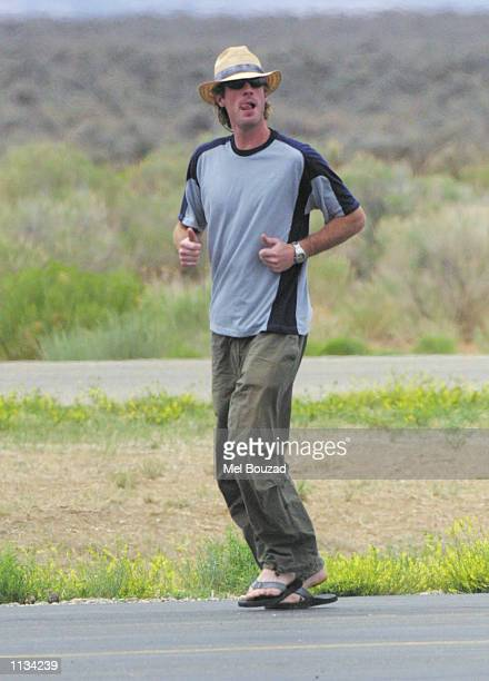 Cameraman Danny Moder runs after saying goodbye to friends at Taos airport on July 6 2002 in Taos New Mexico Moder married actress Julia Roberts in a...