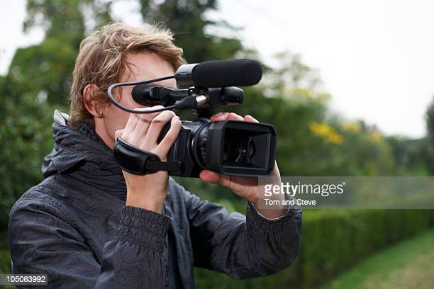 cameraman filming - cinematographer stock pictures, royalty-free photos & images
