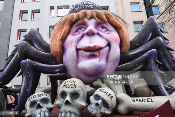 Cameraman films a carnival float depicting German chancellor Angela Merkel as a black widow sitting over the bones and sculls of German politicians...