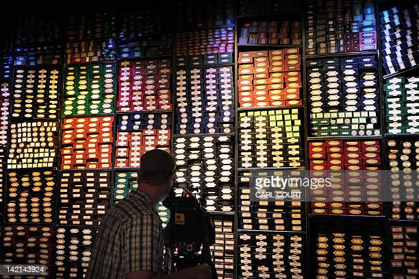 A cameraman films a display of wand boxes during a preview of the Warner Bros Harry Potter studio tour 'The Making of Harry Potter' in north London...