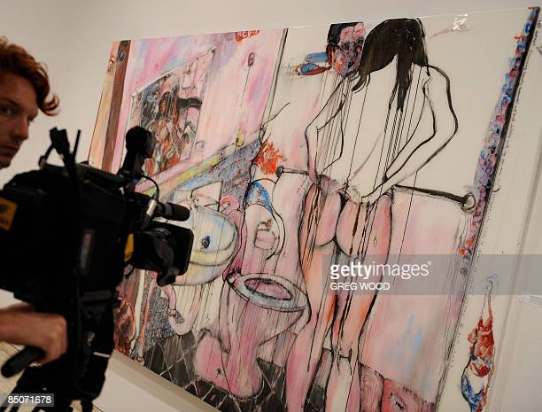 A cameraman films a finalist for the prestigious Archibald Art Prize at the New South Wales Art Gallery in Sydney on February 25 2009 The painting by...