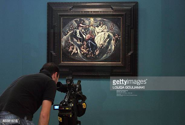 A cameraman films a painting of Domenicos Theotokopoulos known as El Greco The Coronation of the Virgin displayed at the Athens National Gallery on...