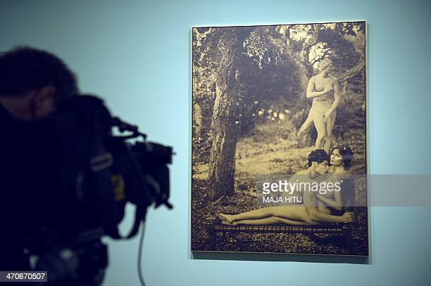 A cameraman films a photo from German fashion designer Karl Lagerfeld's series Modern mythology 2013 in the exhibition Feuerbach's Muses Lagerfeld's...