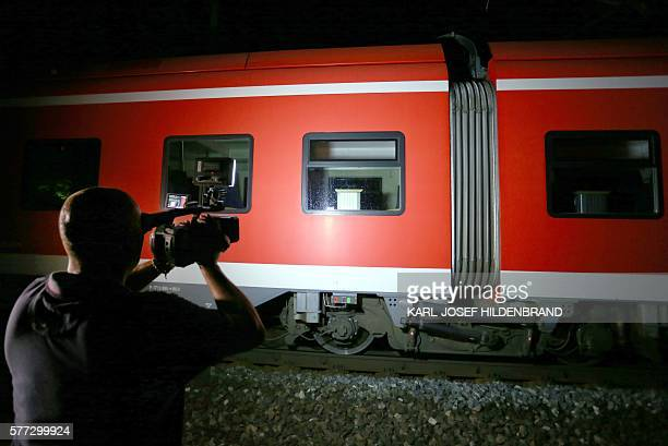 A cameraman films a regional train in Wuerzburg southern Germany on July 18 2016 after a man attacked train passengers with an axe German police...