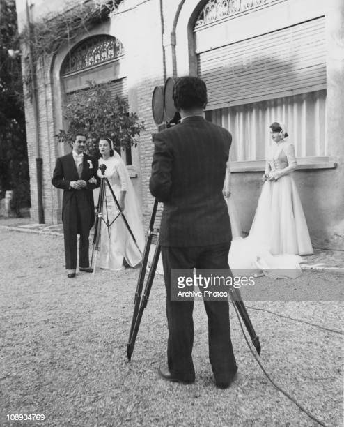 A cameraman films American actor Tyrone Power and Mexican actress Linda Christian at their wedding at the Santa Francesca Romana church in Rome 27th...