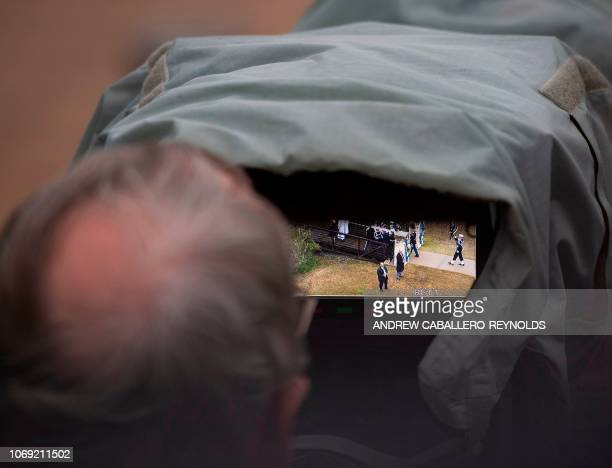 A TV cameraman films as the body of former US President George HW Bush is carried for the interment ceremony at the George HW Bush Presidential...