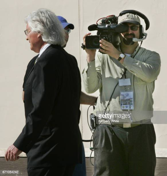 A cameraman films attorney Thomas Mesereau Jr at his client pop singer Michael Jackson's child molestation trial at the Santa Barbara County Court in...