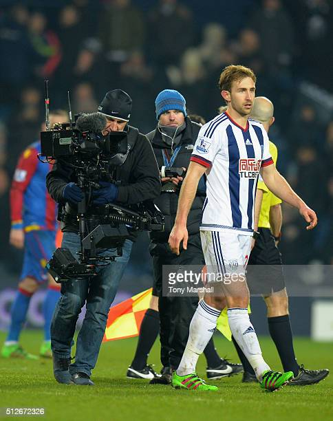 A cameraman films Craig Dawson of West Bromwich Albion after the Barclays Premier League match between West Bromwich Albion and Crystal Palace at The...