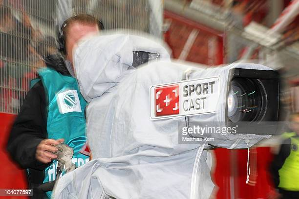 Cameraman films during the Second Bundesliga match between FC Energie Cottbus and Karlsruher SC at Stadion der Freundschaft on September 13, 2010 in...
