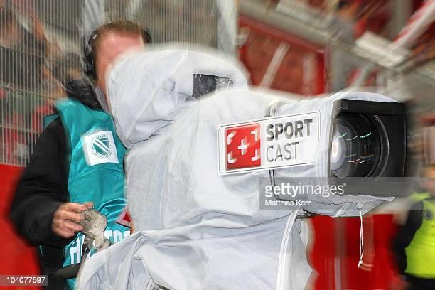 A cameraman films during the Second Bundesliga match between FC Energie Cottbus and Karlsruher SC at Stadion der Freundschaft on September 13 2010 in...