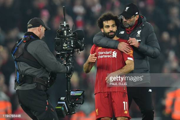 Cameraman films Liverpool's German manager Jurgen Klopp embracing Liverpool's Egyptian midfielder Mohamed Salah at the end of the English Premier...