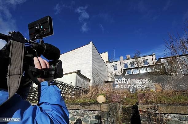 A cameraman films on January 8 2014 in Lichtenberg near Hof southern Germany the back entrance of the house where used to live murder victim Peggy...