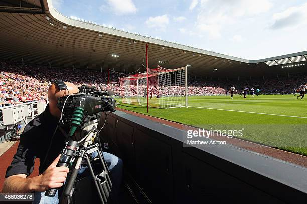 A cameraman films the action during the Barclays Premier League match between Sunderland and Tottenham Hotspur at the Stadium of Light on September...