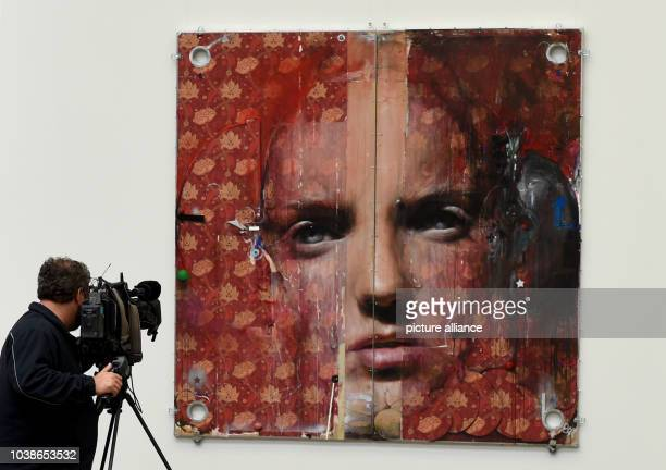 A cameraman films the artwork 'Black Lollipop and Elvis' by Estonian artist Laurentsius which is part of the NordArt exhibition at the Kunstwerk...