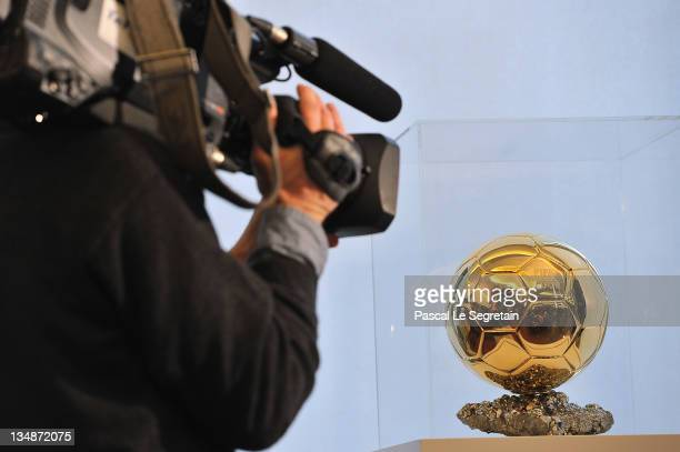 A cameraman films the Ballon D'Or trophy during the FIFA Ballon D'Or Press conference on December 5 2011 in Paris France