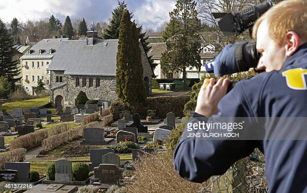 A cameraman films the cemetery of Lichtenberg near Hof southern Germany where a grave was opened on January 8 2014 in connection with the case of a...