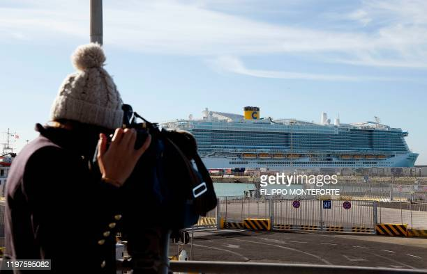 A cameraman films the Costa Smeralda cruise ship docked in the Civitavecchia port 70km north of Rome on January 30 2020 More than 6000 tourists were...