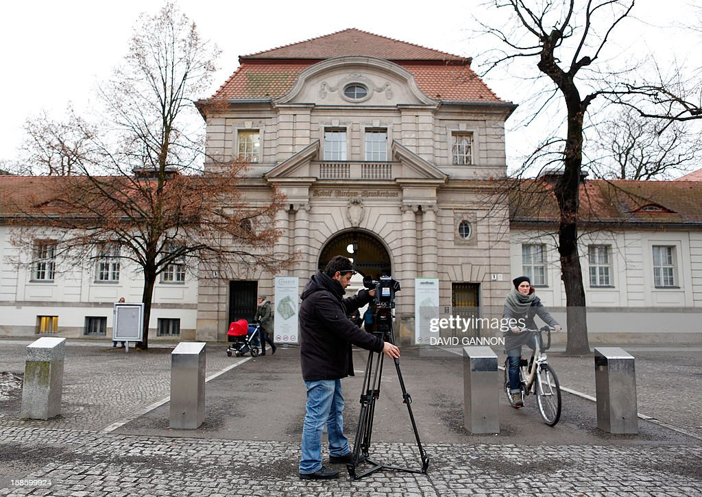 A cameraman films the entrance of the Virchow campus of the Charite, one Europe's largest university hospitals, on December 20, 2012 in Berlin. Iraqi President Jalal Talabani, a key figure who has long sought to bridge bitter divides in his war-scarred country, arrived in Germany on December 20, 2012 for treatment after he suffered a stroke. A spokeswoman for Berlin's Charite said he was receiving treatment there but declined to provide further details. GANNON