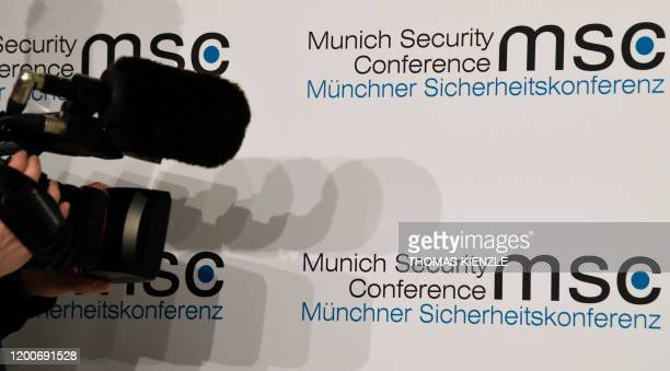 A cameraman films the logo of the Munich Security Conference in Munich southern Germany on February 14 2020 The 2020 edition of the Munich Security...