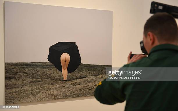 A cameraman films the work Mooning the ArtWorld by Twin Gabriel during a preview of the show Merciless Female Artists and Funny Things on March 8...