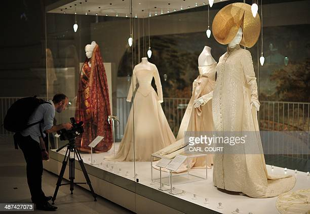 A cameraman films wedding dresses during a press preview for an exhibition entitled 'Wedding Dresses 17752014' at the Victoria Albert Museum in...