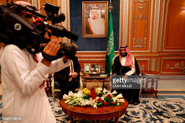 A cameraman gets into position as US Secretary of State Mike Pompeo meets with Saudi Crown Prince Mohammed bin Salman in Riyadh on October 16 2018...