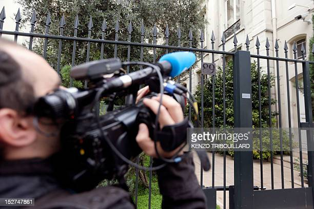 A cameraman grabs pictures of the headquarters of the Wendel Investment group on September 25 2012 in Paris The headquarters of the Wendel Investment...