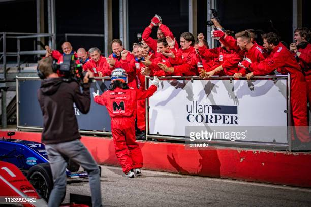 cameraman interviewing formula driver - car racing stock pictures, royalty-free photos & images