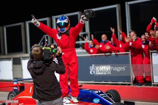 cameraman interviewing formula driver - auto racing stock pictures, royalty-free photos & images