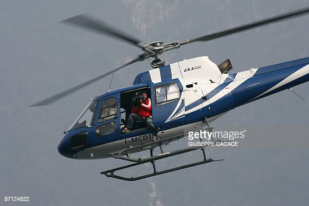 A cameraman is seen on boad of an helicopther flying over Cernobbio 18 March 2006 US film stars Brad Pitt and Angelina Jolie are rumored to be...