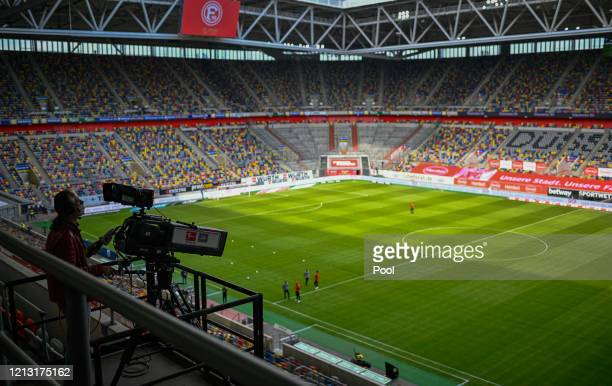 TV cameraman is seen working prior to the Bundesliga match between Fortuna Duesseldorf and SC Paderborn 07 at Merkur SpielArena on May 16 2020 in...