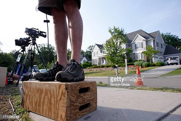 ESPN cameraman Ken Fraser checks his stand up shot outside of New England Patriots Aaron Hernandez's home in North Attleborough Mass June 23 2013...