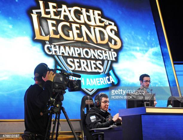 A cameraman lines up his shot of Team Curse Venezuelan player Diego 'Quas' Ruiz before the start of a match against Cloud 9 during the League of...