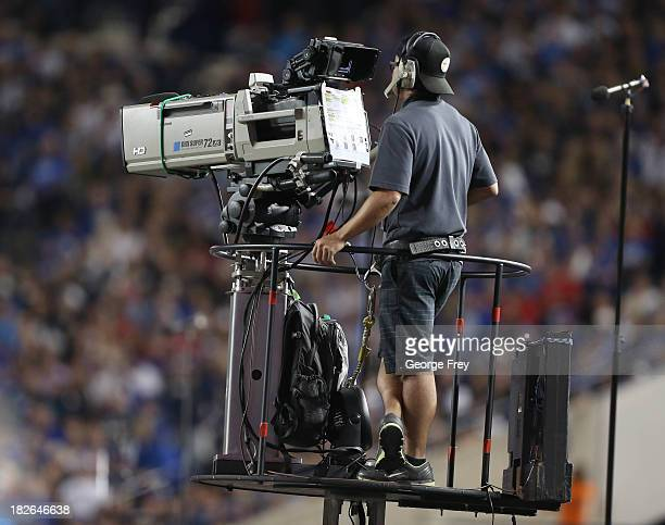 ESPN cameraman mans a camera during a game between the BYU Cougars and the Utah Utes at an NCAA football game September 21 2013 at LaVell Edwards...
