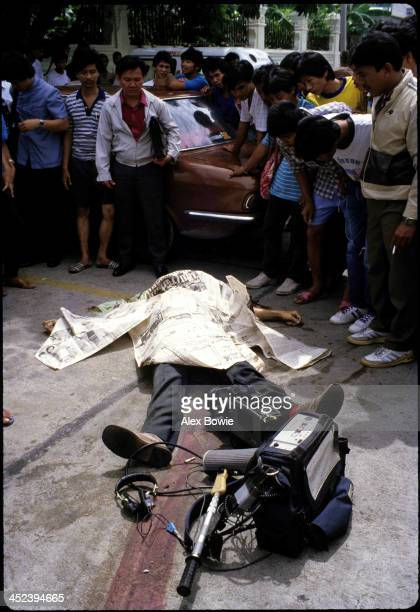 NBC cameraman Neil Davis lays dead in the street after rebel forces had opened fire without warning killing the famous Australian camerman and...