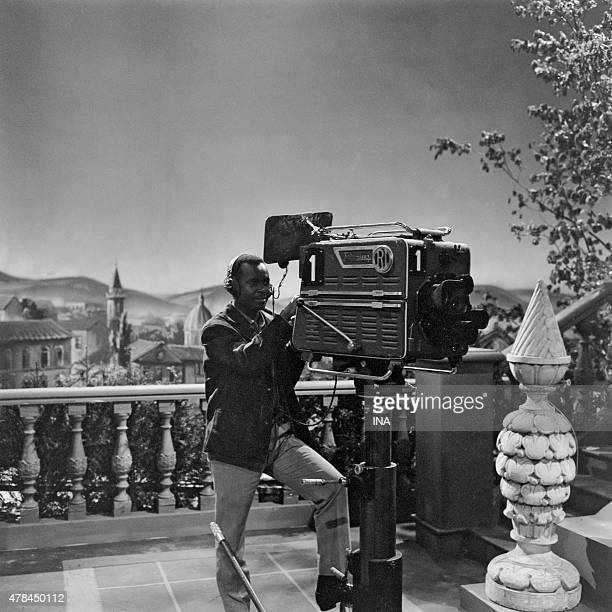 A cameraman on the television studio set of the series Hundred years of love in a studio of the Buttes Chaumont