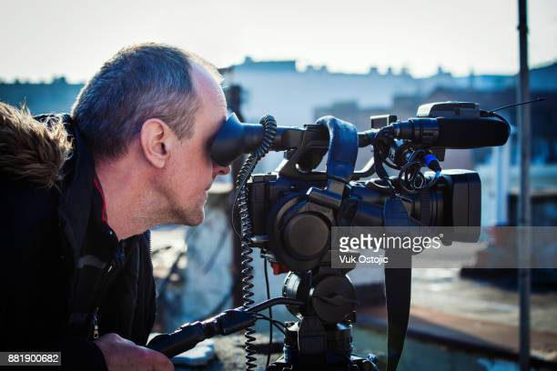 cameraman - cinematographer stock pictures, royalty-free photos & images