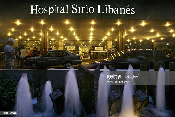 A cameraman records the entrance of the SyrianLebanese hospital where British supermodel Naomi Campbell is hospitalized in Sao Paulo Brazil on...