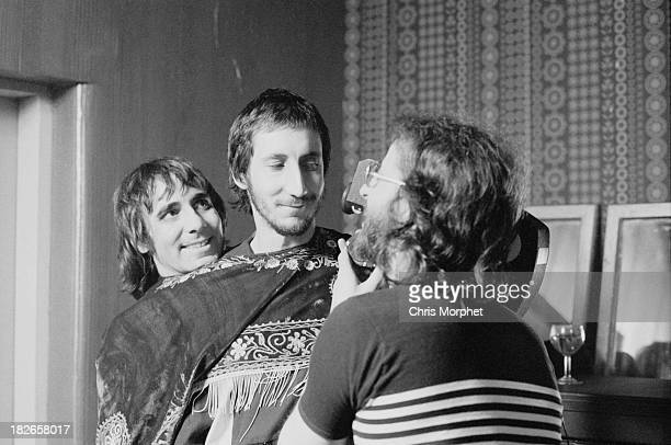 Cameraman Richard Stanley films guitarist Pete Townshend and drummer Keith Moon , of English rock group The Who, in their dressing room before a...