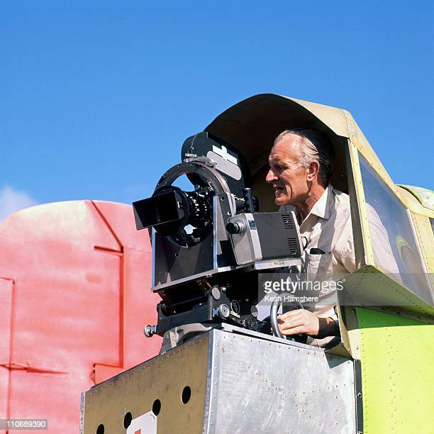 Cameraman Skeets Kelly in the rear camera position of the B25 Mitchell bomber used for filming aerial action sequences for 'Battle Of Britain'...