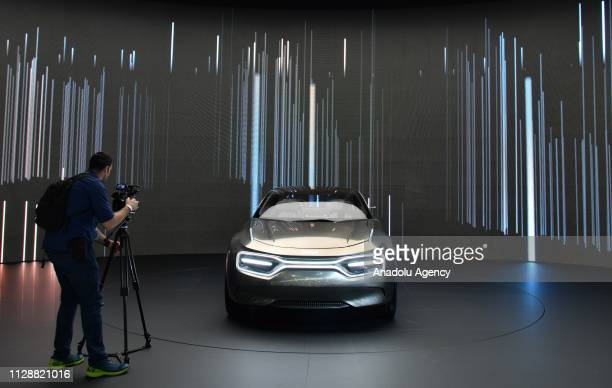 A cameraman takes video of The Korean automaker Kia unveils 'Imagine' electric concept car during the second press day of the 89th Geneva...
