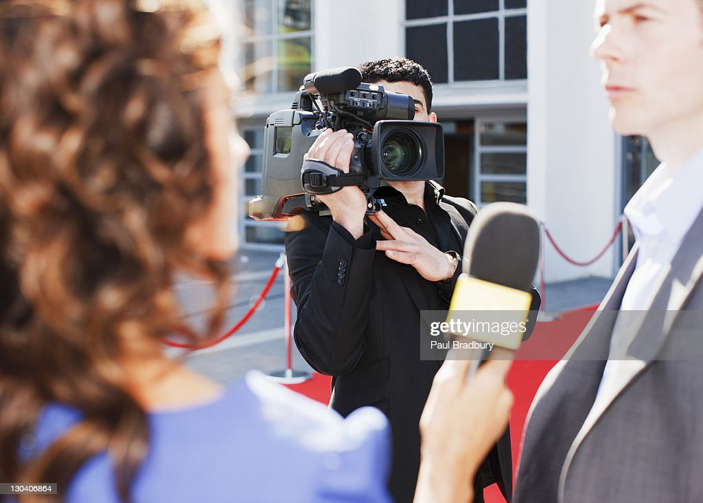 Cameraman taping celebrity on red carpet : Stock Photo