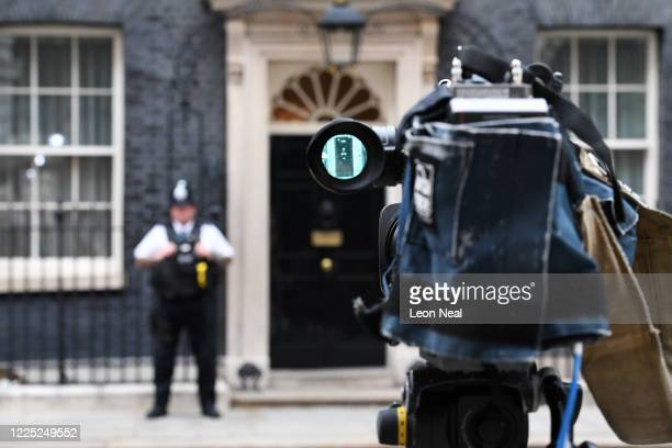 Cameraman trains his lens on the front door of 10 Downing Street before the arrival of EU Chief Negotiator Michel Barnier ahead of a meeting with his...