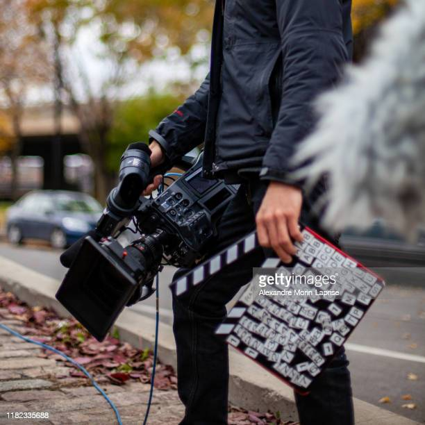 cameraman with all your equipment ready to record on the street - video stock-fotos und bilder
