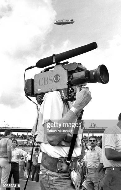 TV cameraman with an Ikegami video camera on his shoulder prepares to broadcast the 1984 Daytona 500 NASCAR race at Daytona International Speedway in...